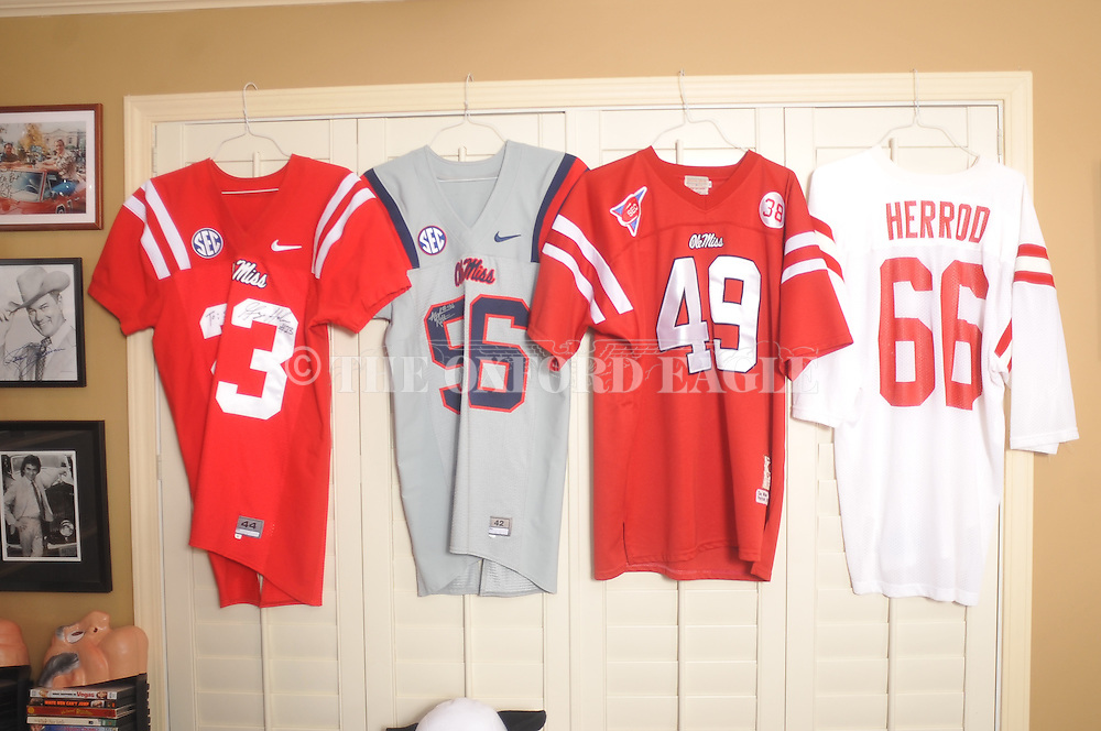 "Game jerseys from former Rebel players (l. to r.) George Helow, Andrew Ritter, Patrick Willis, and Jeff Herrod hang in Smitty Smith's ""Rebel Room"", in Oxford, Miss. on Thursday, October 30, 2014."