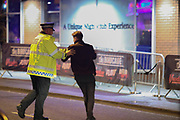MANCHESTER 19.09.2017 A police man pushes a man across the street who was causing trouble.<br /> <br /> Freshers week continues in Manchester which has seen 1000s of students out drinking every night since Sunday.