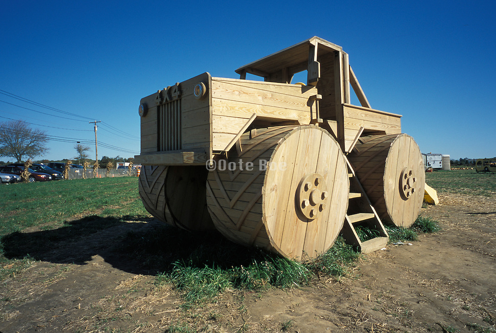 a very big wooden 4x4 toy truck