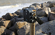 Wingscapes time lapse digital camera mounted on a post at Bawdsey, Suffolk, England, UK