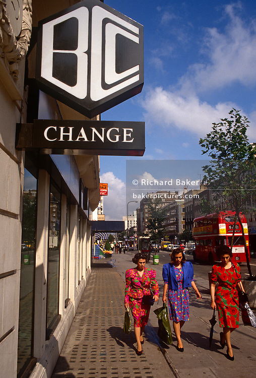 Three women pass beneath the sign of the Bank of Credit and Commerce International (BCCI) in central London in 1991. With a passing red London bus in the road behind, it is a sunny, trouble-free day in the capital. But the bank was forced to shut its doors by the Bank of England amid fraud allegations and the closure lost about 20 local councils up to £30m in investments. (BCCI) was a major international bank founded in 1972 by Agha Hasan Abedi, a Pakistani financier. The Bank was registered in Luxembourg with head offices in Karachi and London. Within a decade BCCI touched its peak. It operated in 78 countries, had over 400 branches, and had assets in excess of US$20 billion, making it the 7th largest private bank in the world by assets.