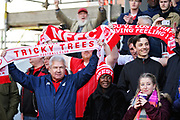 Forest fans with scarves before the EFL Sky Bet Championship match between Nottingham Forest and Blackburn Rovers at the City Ground, Nottingham, England on 13 April 2019.