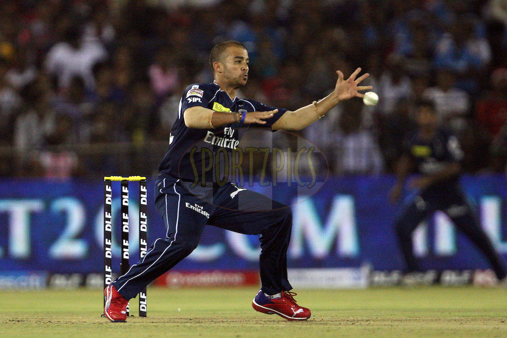 JP Duminy fields off his own bowling, hurting his hand in the process during match 42 of the the Indian Premier League ( IPL) 2012  between The Deccan Chargers and the Pune Warriors India held at the Barabati Stadium, Cuttack on the 1st May 2012..Photo by: Jacques Rossouw/IPL/SPORTZPICS