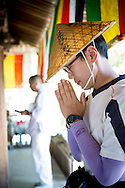 Prayer at one of the 88 temples associated with the Buddhist monk Kūkai (Kōbō Daishi) on the island of Shikoku, Japan.