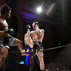 PETER IRVING BLOCKS A KICK FROM GALORE BOFANDO - UCMMA 34 2 JUNE 2013
