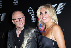 John Caudwell; Claire Johnson, F1 Party in aid of Great Ormond Street Hospital Children's Charity, Victoria and Albert Museum, London UK, 02 July 2014, Photo by Richard Goldschmidt © Licensed to London News Pictures. 03/07/2014