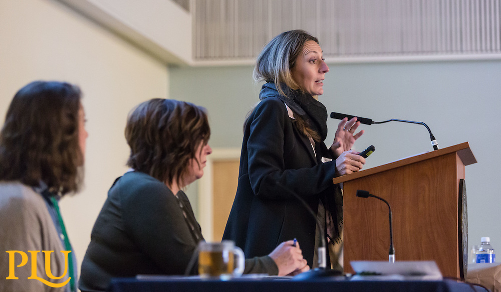 F.K. Clement, speaking with Lexi Jason '17, far left, and Prof. Lisa Marcus, left, during the Powell-Heller Holocaust Conference at PLU, Wednesday, Oct. 19, 2016. (Photo: John Froschauer/PLU)