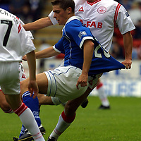 St Johnstone v Aberdeen.... 25.8.01<br />Cato Guntveit tugs on the shirt of Ross Forsyth<br /><br />Pic by Graeme Hart<br />Copyright Perthshire Picture Agency<br />Tel: 01738 623350 / 07990 594431