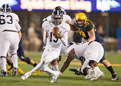 Sep 5, 2015; Morgantown, WV, USA; Georgia Southern Eagles quarterback Favian Upshaw bobbles a snap in the second quarter against the West Virginia Mountaineers at Milan Puskar Stadium.  Mandatory Credit: Ben Queen-USA TODAY Sports