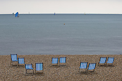 May 7, 2018 - Brighton, East Sussex, United Kingdom - Brighton, UK. Deckchairs stand unused on the beach in Brighton and Hove as low temperatures and grey clouds are hitting the seaside resort. (Credit Image: © Hugo Michiels/London News Pictures via ZUMA Wire)
