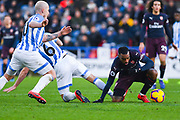 Alexandre Lacazette of Arsenal (9) escapes Jonathan Hogg of Huddersfield Town (6) during the Premier League match between Huddersfield Town and Arsenal at the John Smiths Stadium, Huddersfield, England on 9 February 2019.