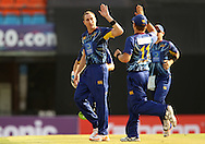 James McMillan of Otago Volts celebrates the wicket of Ali Waqas of the Faisalabad Wolves during the Qualifier 1 match of the Karbonn Smart Champions League T20 (CLT20) between Otago Volts and the Faisalabad Wolves held held at the Punjab Cricket Association Stadium, Mohali on the 17th September 2013<br /> <br /> Photo by Ron Gaunt/CLT20/SPORTZPICS<br /> <br /> <br /> Use of this image is subject to the terms and conditions as outlined by the CLT20. These terms can be found by following this link:<br /> <br /> http://sportzpics.photoshelter.com/image/I0000NmDchxxGVv4<br /> <br /> ENTER YOUR EMAIL ADDRESS TO DOWNLOAD