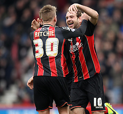 Bournemouth's Brett Pitman celebrates his third goal with Bournemouth's Matt Ritchie - Photo mandatory by-line: Robbie Stephenson/JMP - Mobile: 07966 386802 - 14/03/2015 - SPORT - Football - Bournemouth - Dean Court - AFC Bournemouth v Blackpool - Sky Bet Championship