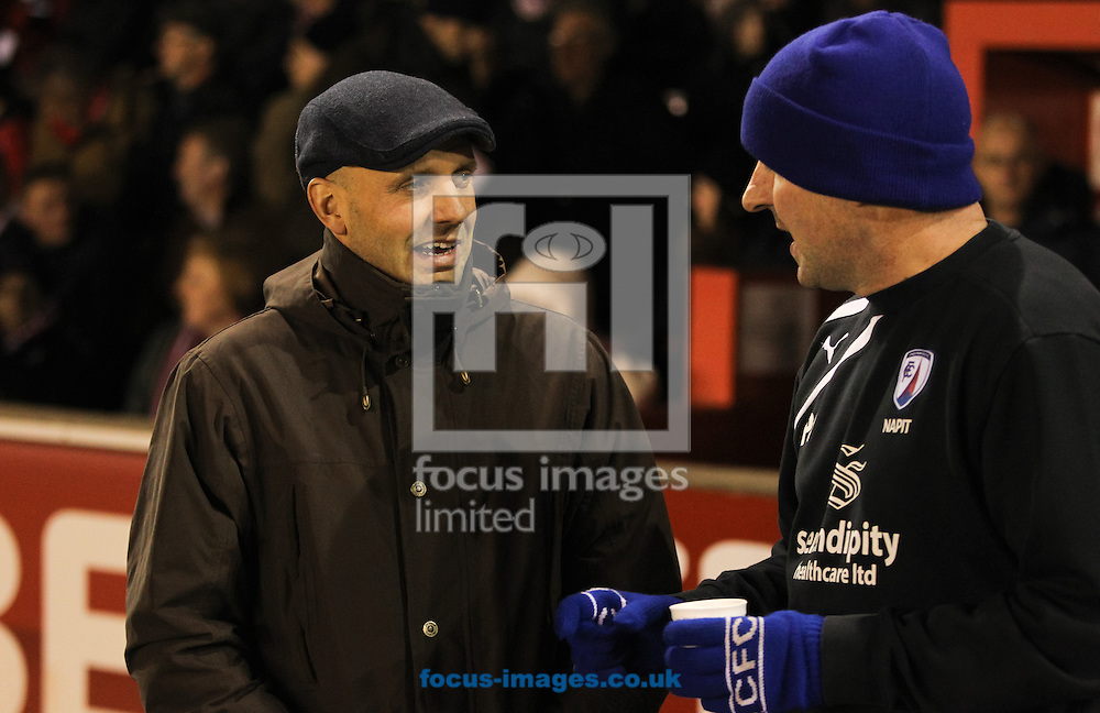 Picture by Tom Smith/Focus Images Ltd 07545141164<br /> 20/12/2013<br /> Exeter City manager Paul Tisdale (left) and Chesterfield manager Paul Cook (right) greet each other before the Sky Bet League 2 match at St James' Park, Exeter.