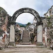 Stairs and archway at the ruins of the Iglesia y Convento de La Recolección in Antigua, Guatemala. The church was destroyed by the earthquake of 1773.