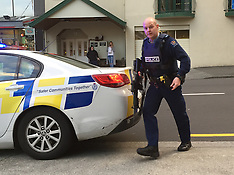 Wellington-Police load rifle and head away from  Boulcott Street