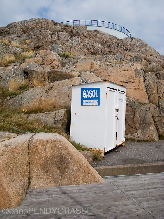 Storage shack at a seaside gas station on the water in Sweden. What is that in the foreground?