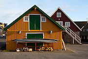 Old houses and kayaks, at the old harbour, Nuuk, Greenland. Photo Copyright 2009 Dave Walsh
