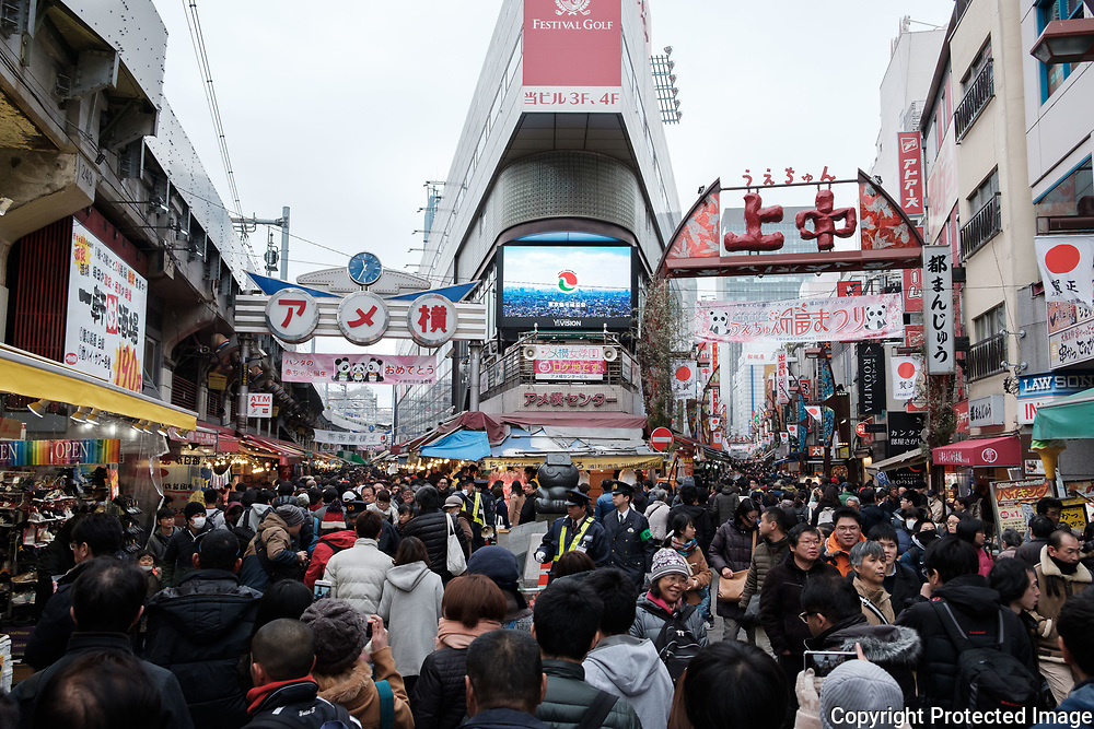 "Streets are crowded by tourists and shoppers at the Ameyoko market, Ueno in Tokyo Sunday, Dec. 31, 2017. Ameyoko market is crowded by shoppers who look for discounts on ingredients for ""osechi"" or Japanese traditional New Year dishes. 31/12/2017-Tokyo, JAPAN"