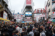 """Streets are crowded by tourists and shoppers at the Ameyoko market, Ueno in Tokyo Sunday, Dec. 31, 2017. Ameyoko market is crowded by shoppers who look for discounts on ingredients for """"osechi"""" or Japanese traditional New Year dishes. 31/12/2017-Tokyo, JAPAN"""