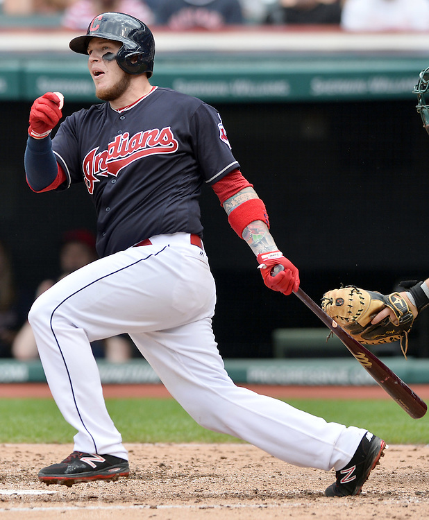 Jul 31, 2016; Cleveland, OH, USA; Cleveland Indians catcher Roberto Perez (55) hits an RBI single during the fourth inning against the Oakland Athletics at Progressive Field. Mandatory Credit: Ken Blaze-USA TODAY Sports