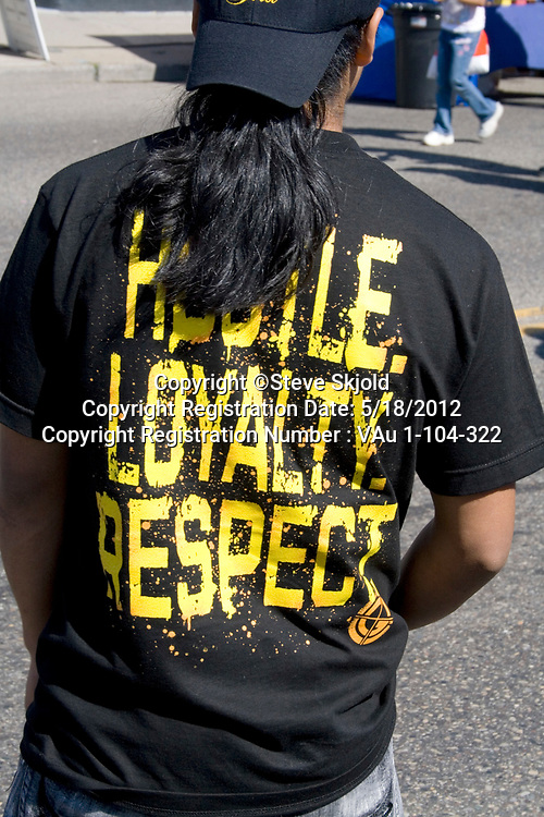 Mexican American teen wearing shirt printed with Habile Loyalty Respect. Mexican Independence Day Minneapolis Minnesota MN USA
