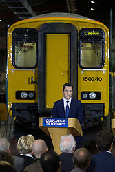 © Licensed to London News Pictures . 20/04/2015 . Crewe , UK . GEORGE OSBORNE . David Cameron and George Osborne campaigning in an Arriva train shed in Crewe , Cheshire as part of the Conservative Party's election run . Photo credit : Joel Goodman/LNP