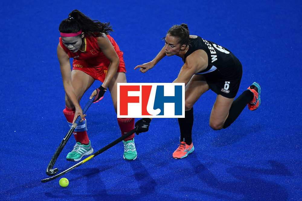 China's Cui Qiuxia (L) and New Zealand's Petrea Webster vie during the women's field hockey China vs New Zealand match of the Rio 2016 Olympics Games at the Olympic Hockey Centre in Rio de Janeiro on August, 13 2016. / AFP / MANAN VATSYAYANA        (Photo credit should read MANAN VATSYAYANA/AFP/Getty Images)