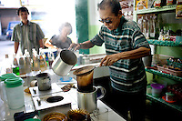 An Indonesian man makes Acehnese coffee at a cafe in Banda Aceh, Monday, Nov. 9, 2009.