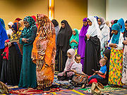 04 JUNE 2019 - DES MOINES, IOWA: Women pray during Eid al Fitr services in the Iowa Events Center in Des Moines Tuesday. About 3,000 people were expected to attend the annual community wide celebration of Eid al Fitr which marks the end of Ramadan, the Muslim month of fasting. According to the event organizers, there are about 15,000 Muslims in the Des Moines area.           PHOTO BY JACK KURTZ