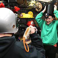 Chris Carlyle, 15, of Booneville, tries on a Top Hat as he shops for a Halloween costume with his sister Alyshia, who tries on a football helmet, on Monday at Spirit Halloween in Tupelo on Monday morning. Spirit Halloween has one more weekend to be open for the Halloween.