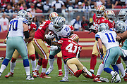 San Francisco 49ers strong safety Antoine Bethea (41) makes a tackle on Dallas Cowboys running back Ezekiel Elliott (21) at Levis Stadium in Santa Clara, Calif., on October 2, 2016. (Stan Olszewski/Special to S.F. Examiner)