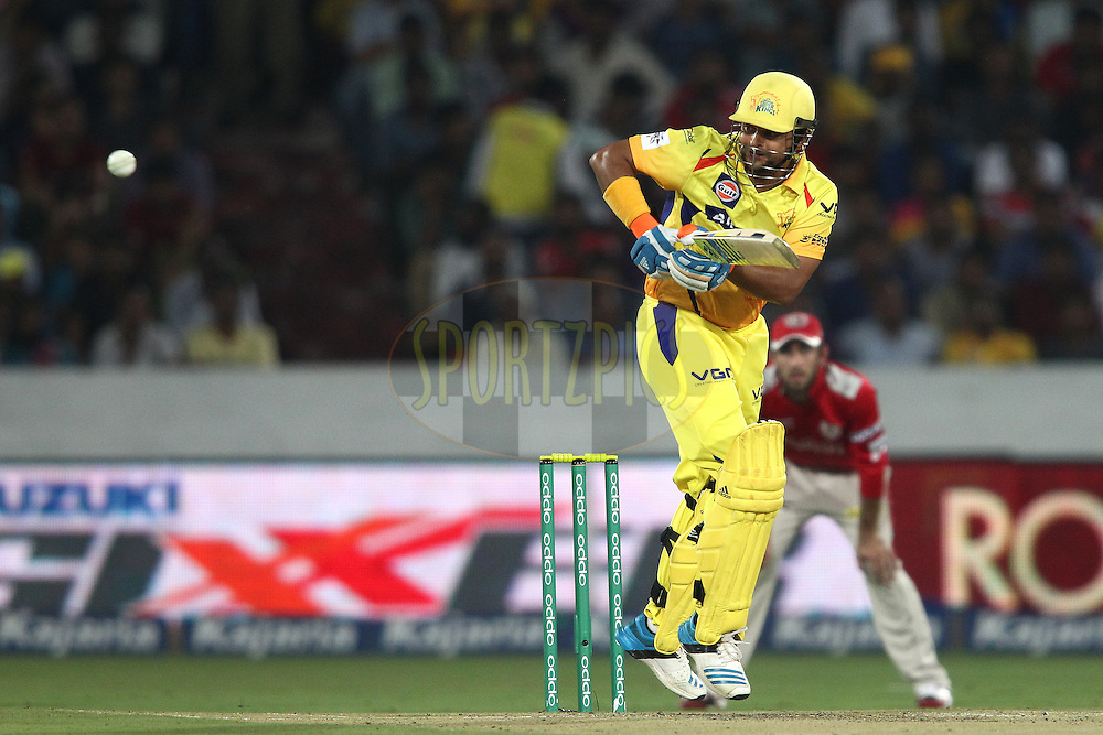 Suresh Raina of the Chennai Super Kings plays a delivery through the leg side during the second semi final match of the Oppo Champions League Twenty20 between the Kings XI Punjab and the Chennai Superkings held at the Rajiv Gandhi Cricket Stadium, Hyderabad, India on the 2nd October 2014<br /> <br /> Photo by:  Shaun Roy / Sportzpics/ CLT20<br /> <br /> <br /> Image use is subject to the terms and conditions as laid out by the BCCI/ CLT20.  The terms and conditions can be downloaded here:<br /> <br /> http://sportzpics.photoshelter.com/gallery/CLT20-Image-Terms-and-Conditions-2014/G0000IfNJn535VPU/C0000QhhKadWcjYs