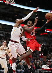 January 27, 2019 - Chicago, IL, USA - Chicago Bulls guard Kris Dunn (32) misses a shot in the final minute against Cleveland Cavaliers guard Rodney Hood (1) on Sunday, Jan. 27, 2019 at the United Center in Chicago, Ill. The Cavaliers defeated the Bulls, 104-101. (Credit Image: © Brian Cassella/Chicago Tribune/TNS via ZUMA Wire)