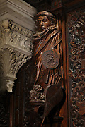 Allegorical walnut wood sculpture by Francesco Pianta, 1657-76, in the Sala Capitolare or Chapter Room, in the Scuola Grande di San Rocco, a lay confraternity founded in 1478, based on the cult of St Roch, in San Polo in Venice, Italy. The series is moralising in tone, with vices and virtues, and representations of the arts. The sculptures are dossali, originally intended for the rear of an altar. Picture by Manuel Cohen