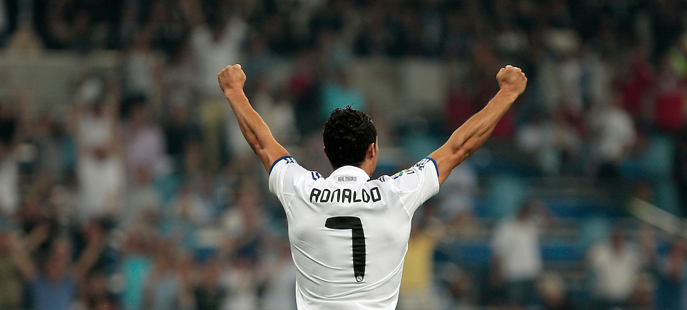 Real Madrid's Cristiano Ronaldo from Portugal, reacts during their Spanish La Liga soccer match against Osasuna after Carvalho from Portugal scoring a goal at the Santiago Bernabeu stadium in Madrid, Saturday, Sept. 11, 2010.