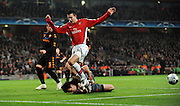 Robin Van Persie of Arsenal  tries to beat Doni of AS Roma during the UEFA Champions League First knockout round, First Leg match between Arsenal and A.S. Roma at Emirates Stadium on February 24, 2009 in London, England.