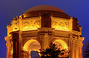The buildings of the Palace of Fine Arts in San Francisco are lit up after the sun sets.