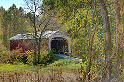 2015 Oct 19:   Parke County Indiana is the site of the Indiana Covered Bridge Festival every October.  This is the Mill Creek Bridge.  It was built over Mill Creek on Tow Path Road in 1907 by Wm. Hendricks and D.M. Brown and is a 92' span.<br /> <br /> This image was produced in part utilizing High Dynamic Range (HDR) processes.  It should not be used editorially without being listed as an illustration or with a disclaimer.  It may or may not be an accurate representation of the scene as originally photographed and the finished image is the creation of the photographer.