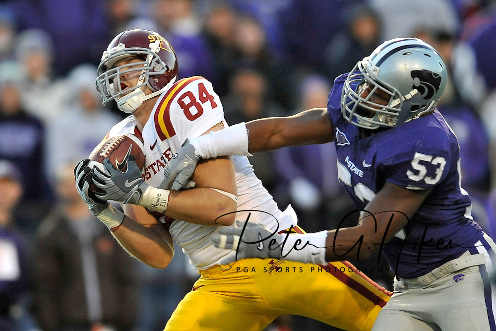 MANHATTAN, KS - NOVEMBER 22:  Full Back Derrick Catlett #84 of the Iowa State Cyclones catches a first down pass against pressure from linebacker Reggie Walker #53 of the Kansas State Wildcats during the fourth quarter on November 22, 2008 at Bill Snyder Family Stadium in Manhattan, Kansas.  Kansas State won 38-30.