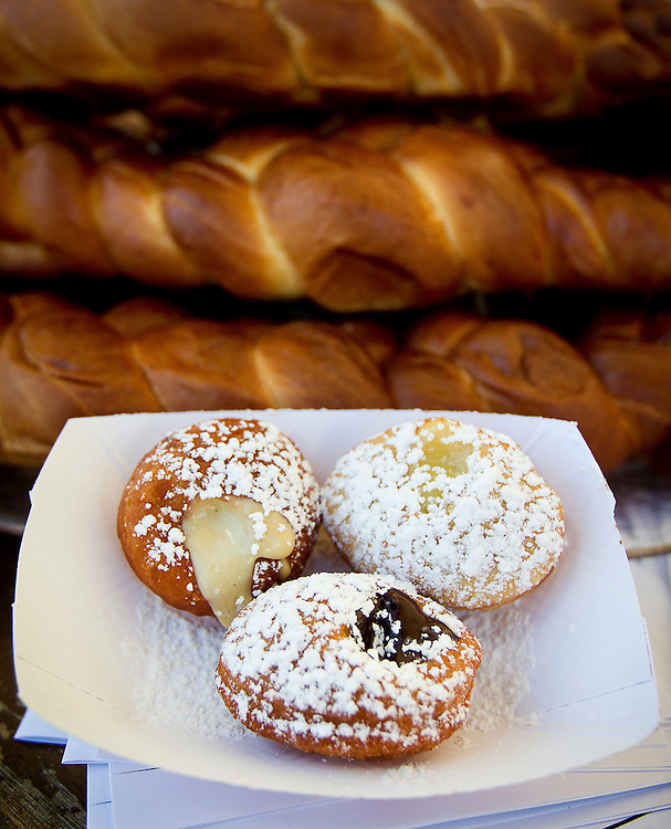 A trio of petit sufganiyot's (Israeli donuts), lemon curd, budino, chocolate Nutella ganache from Adamah Neighborhood Table.