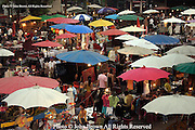 The Sunday evening Night Market, located at the Tha Pae Gate in Chiang Mai, Thailand, is filled with shoppers looking for bargains. The market contains dozens of food stalls, and handicraft shops, many of which offer traditional and local Thai items and clothing for sale.