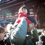 TOKYO, JAPAN - JANUARY 1 : A father carry his daughter after praying at Sensoji Buddhist temple in Asakusa district, Tokyo on Sunday, January 1, 2017. Japan celebrated the start of 2017 for the Year of the Rooster. (Photo by Richard Atrero de Guzman/NURPhoto)