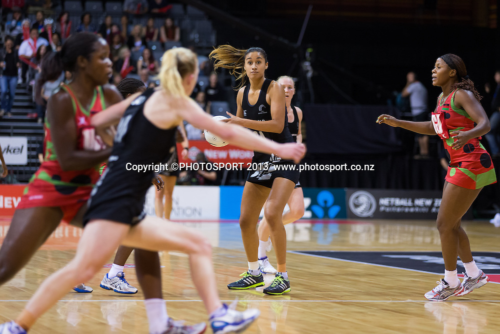 Silver Ferns' GA Maria Tutaia passes to Laura Langman during the New World Netball Series - Silver Ferns v Malawi, won by NZ 72-39 at Claudelands Arena, Hamilton, New Zealand, Thursday 31 October 2013. Photo: Stephen Barker/Photosport.co.nz