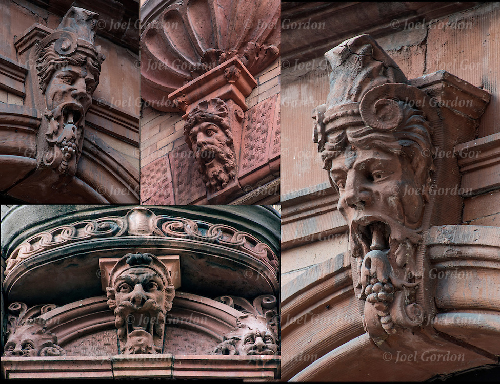 Carved stone faces on exterior of 19th century building in the East Village, NYC