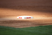 ANAHEIM, CA - AUGUST 2:  Third base is lit up in the sun during the Los Angeles Angels of Anaheim game against the Toronto Blue Jays on Friday, August 2, 2013 at Angel Stadium in Anaheim, California. The Angels won the game 7-5. (Photo by Paul Spinelli/MLB Photos via Getty Images)