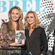 NLD/Amsterdam/20190221- boekpresentatie Daphne Deckers:  'Dubbel Zes', Daphne Deckers geeft het eerste boek aan  Kelly Weekers