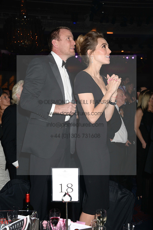 British fine jewellery brand Boodles welcomed guests for the 2013 Boodles Boxing Ball in aid of Starlight Children's Foundation held at the Grosvenor House Hotel, Park Lane, London on 21st September 2013.<br /> Picture Shows:-GUY RITCHIE and JACKIE AINSLEY<br /> <br /> Press release - https://www.dropbox.com/s/a3pygc5img14bxk/BBB_2013_press_release.pdf<br /> <br /> For Quotes  on the event call James Amos on 07747 615 003 or email jamesamos@boodles.com. For all other press enquiries please contact luciaroberts@boodles.com (0788 038 3003)