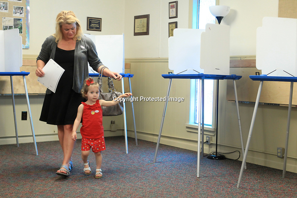 Melonie Carlson walks with her daughter, Gracie, 2, after casting her vote for the Ward 6 City Council race at the Wildwood Baptist Church Precinct 10 location on Tuesday morning in Tupelo.
