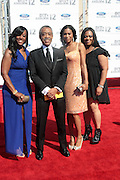 June 30, 2012-Los Angeles, CA : (L-R) Dominique Sharpton, Rev. Al Sharpton, President, National Action Network, Guest, and Ashely Sharpton attends the 2012 BET Awards held at the Shrine Auditorium on July 1, 2012 in Los Angeles. The BET Awards were established in 2001 by the Black Entertainment Television network to celebrate African Americans and other minorities in music, acting, sports, and other fields of entertainment over the past year. The awards are presented annually, and they are broadcast live on BET.(Photo by Terrence Jennings)
